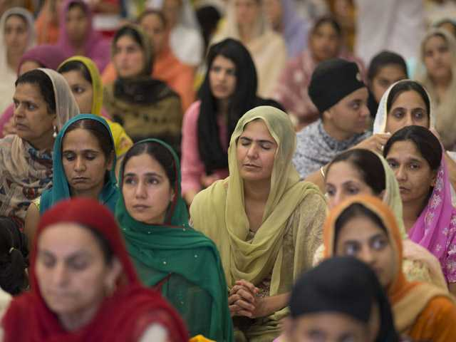 People attend a prayer service at the Sikh Temple of Wisconsin in Oak Creek, Wis., on Sunday.
