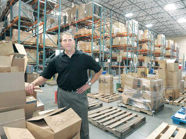 Vice President of Operations Mike Klepfer surveys the AMS Fulfillment warehouse in Valencia on May 24.