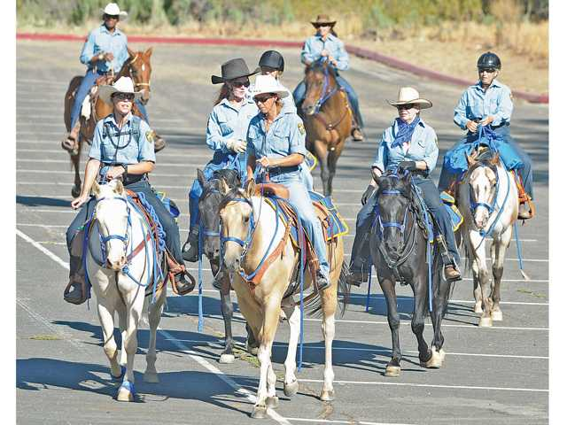 Members of the North County Mounted Patrol Assistance Unit form up in the parking lot to begin their patrol of Castaic Lake on Thursday.