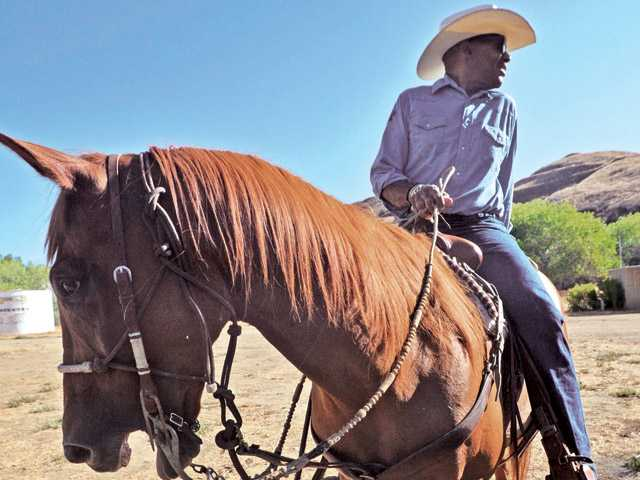 Darvin White and Dodge of North County Mounted Patrol Assistance Unit prepare to patrol.
