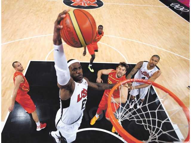 United States player LeBron James (6) dunks against Spain during the men's gold medal basketball game in London on Sunday.