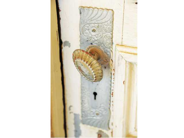 An original door knob is seen on one of the entry doors of the Mentryville home.