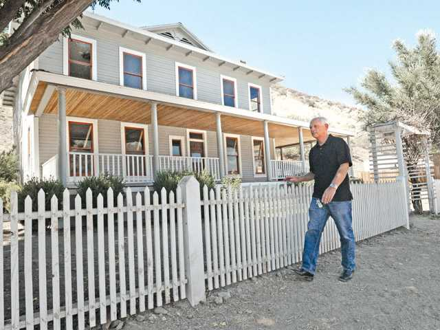 Harte walks in front of the home in Newhall.