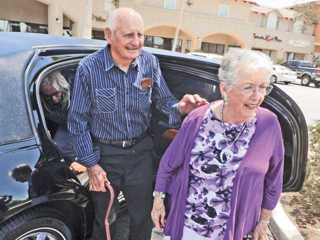 Richard and Joyce Ziegenfuss exit a limousine as they attend their 65th anniversary luncheon held at Wolf Creek Restaurant & Brewing Company in Valencia on Saturday.
