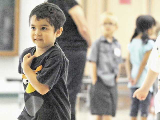 Ethan Kamins takes a tour of the multipurpose room with his class on his first day at Castaic Elementary School on Monday.