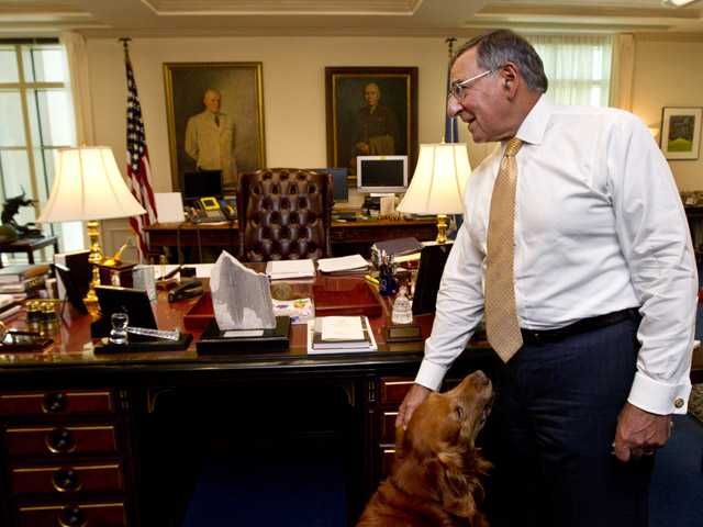 Defense Secretary Leon Panetta, with his golden retriever dog Bravo, during an interview with The Associated Press on Monday at the Pentagon.