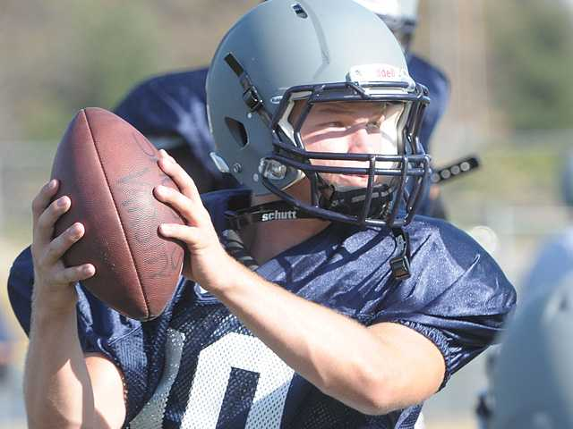 Saugus sophomore quarterback Chris Hamilton throws a pass in practice on Friday. The 5-foot-11-inch, 185-pound player has been named the starting quarterback for the Centurions.