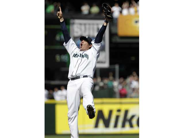 Seattle Mariners pitcher Felix Hernandez reacts after throwing a perfect game against the Tampa Bay Rays on Wednesday in Seattle.