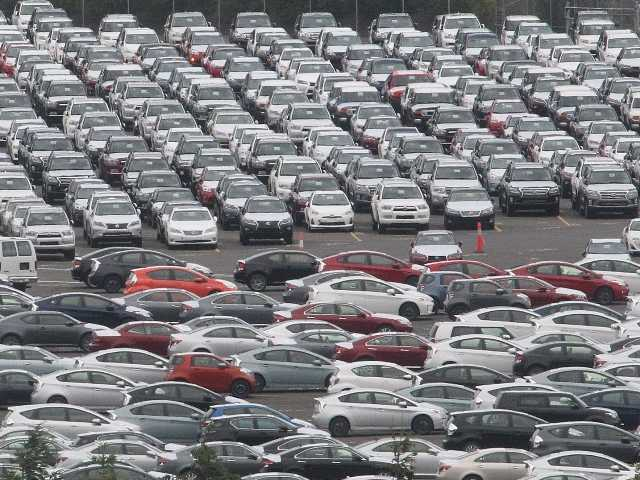 This June photo shows cars parked at the Toyota auto terminal at the Port of Portland in Oregon.