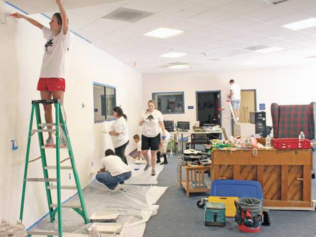 Volunteers paint the Teen Center at the Boys & Girls Club of Santa Clarita Valley Sierra Vista location