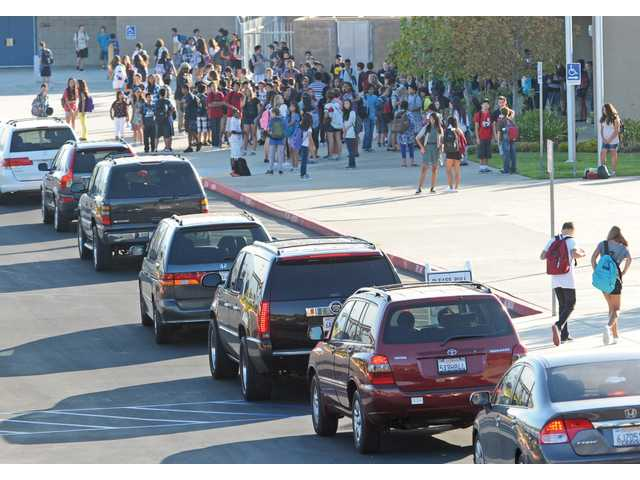 Cars line the drop-off zone as Rancho Pico Junior High students wait for the gates to open for the first day in Stevenson Ranch on Thursday.