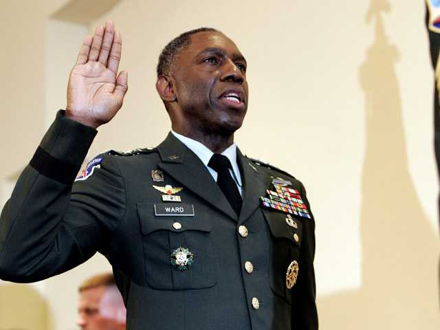In this 2006 photo, Army Lt. Gen. William E. Kip Ward is adminstered the oath of four-star general, the Army's highest rank of general, by Command Sgt. Major Mark Ripka, right, at Fort Myer, Va.