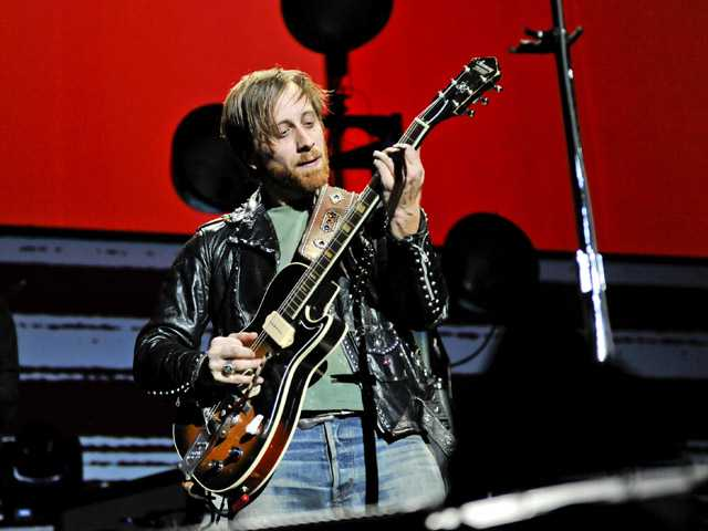 In this March 12, 2012 file photo, guitarist/vocalist Dan Auerbach of The Black Keys performs at Madison Square Garden, in New York.