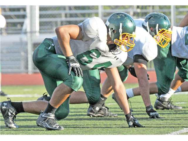 Prep football: On the defensive