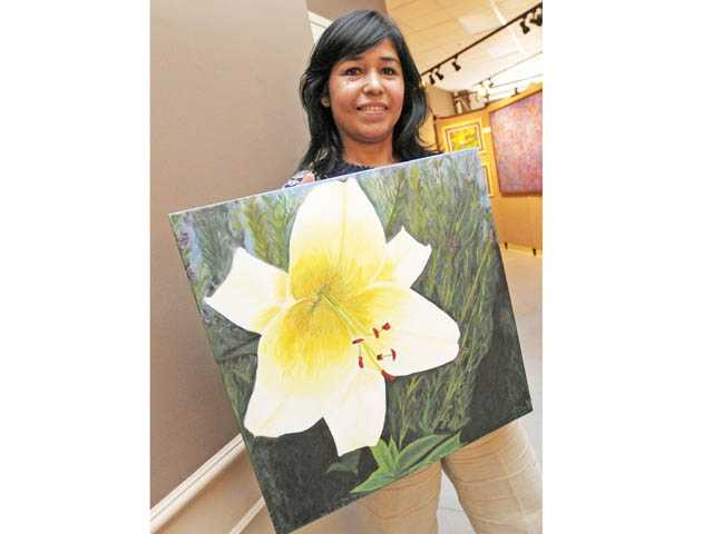 "Tere Schwartzbart displays her acrylic painting ""I Am December Bloom."" Schwartzbart is one of 40 artists on display."