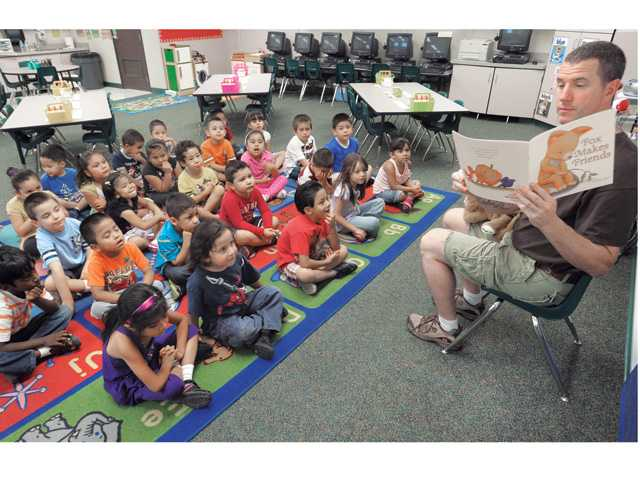 Kindergarten teacher Mike Parker reads a book to his class.