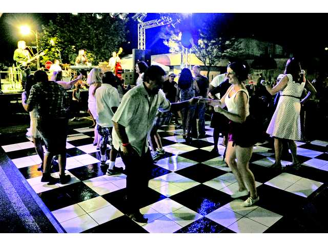 Reuben and Pamela Sosa, of Valencia, dance to the rockabilly songs performed by The Dusk Devils at Senses on Main Street in Newhall on Thursday.