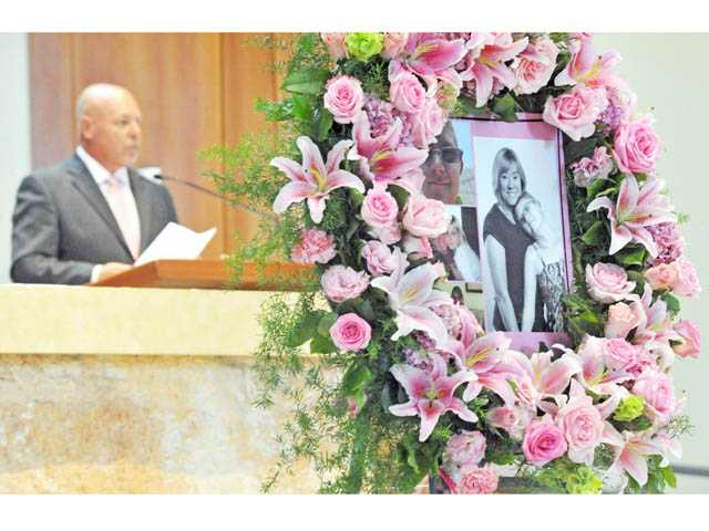 Family friend Doug Kreuzberger delivers the eulogy for Melissa Grason during a celebration of her life at Blessed Kateri Tekakwitha Catholic Church in Saugus on Saturday.