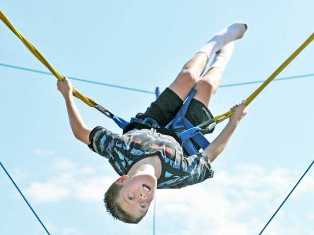 Colin Ferry, 11, flips at the YOUth Sports Festival at the Santa Clarita Sports Complex on Saturday.
