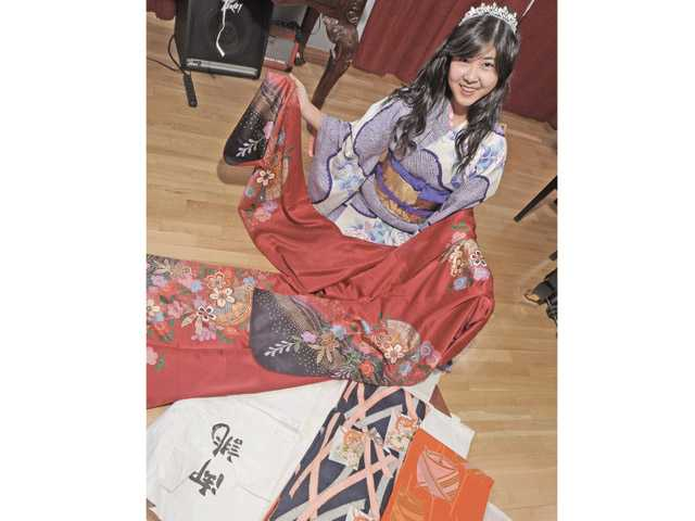 Mina Matsumoto displays the silk kimonos sent to her from Japan.