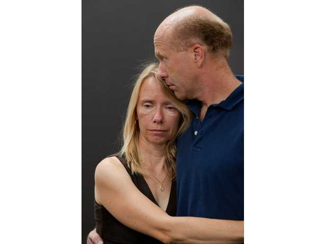 Marianne Lomax, left, and her husband Craig Lomax embrace after speaking to members of the press about the ongoing search for their missing daughter, Linnea Lomax, at the Sheriff's office in Placerville.