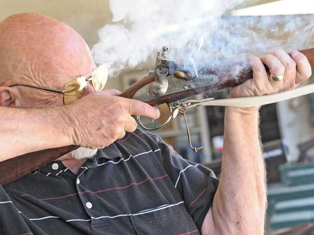 Smoke explodes from Burbank Muzzle Loaders member Kent Burton's musket at Wes Thompson's Shooting Piru Gun Range on Wednesday.