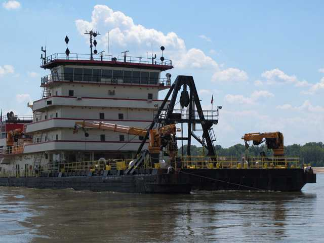 The 350-foot U.S. Army Corps of Engineers' Dredge Hurley works to clear a navigation channel on the Mississippi River on Monday.