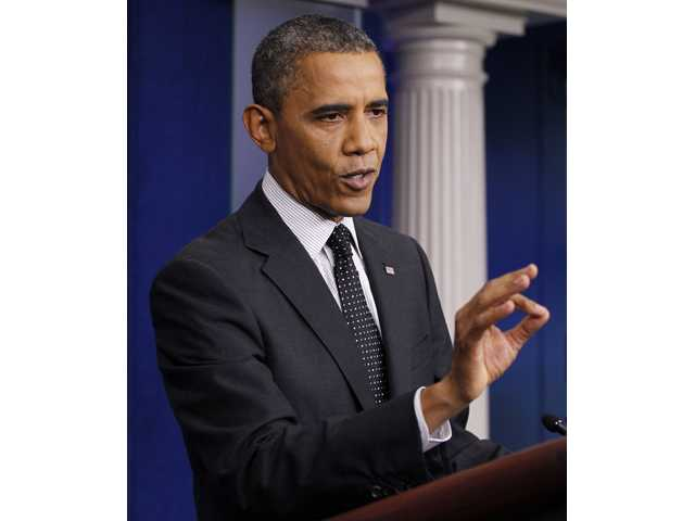 President Barack Obama gestures while speaking in the White House briefing room in Washington, Monday.
