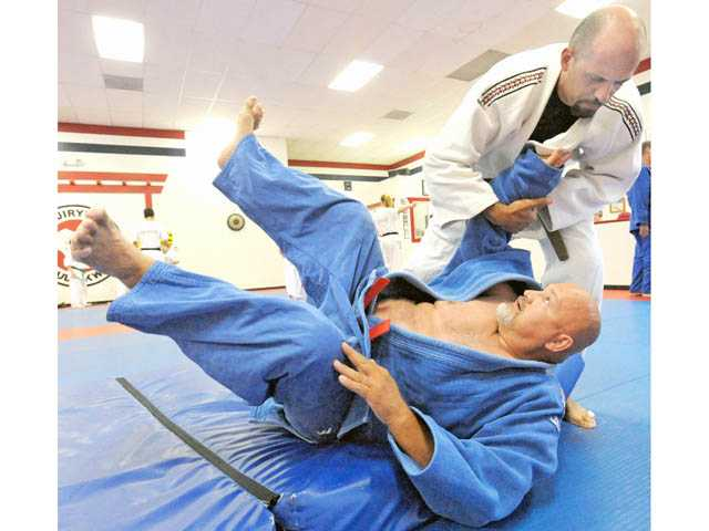 Levon Mendelyan, above, practices a throwing technique with Sensei Mark Guerrero of the Santa Clarita Judo Club at Santa Clarita Karate in Saugus recently.