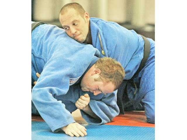 Brothers Adam, top, and Matt Weiner engage in newaza randori, or sparring in ground work.