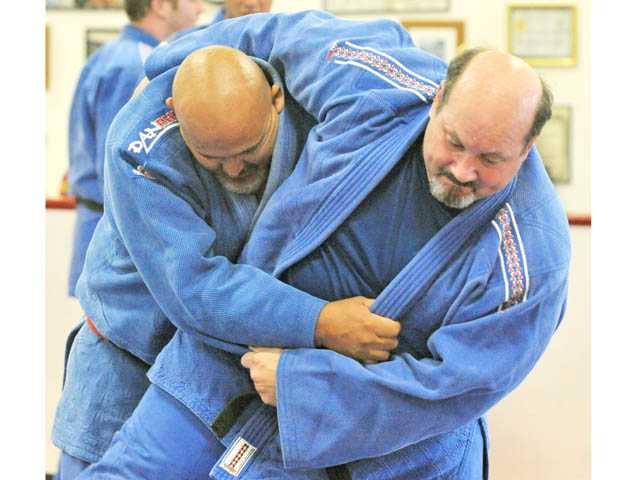 Senseis Mark Guerrero, left, and Richard Weiner engage in drills during a practice of the Santa Clarita Judo Club at Santa Clarita Karate in Saugus  recently.