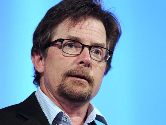 In this June 15, 2012 file photo, Michael J. Fox speaks at the Middlesex Community College Celebrity Forum in Lowell, Mass.