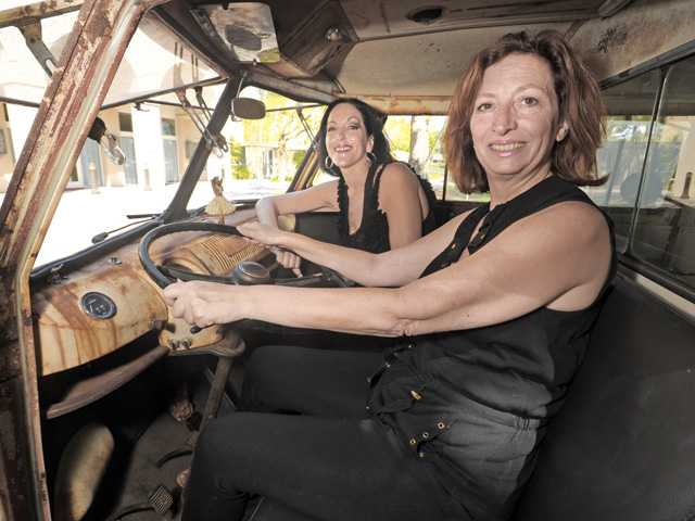 Shelley Hann, left, and JoAnn Vigdigni of SCV Women and Men of Honor, show off the interior of an unrestored, vintage Vokswagen split window van. The van, with its original patina, will be auctioned off  during the SCV Women and Men of Honor event on Sept. 8.