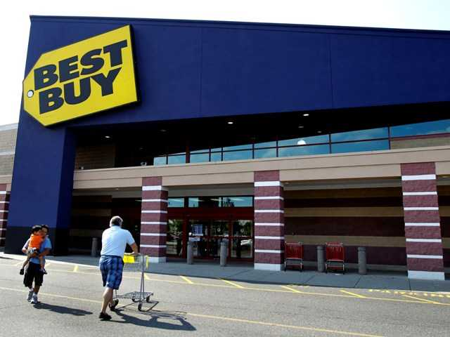 In this Thursday, June 21, 2012, at a Best Buy in Danvers, Mass. On Monday the company reported a 90 percent drop in net income last quarter.