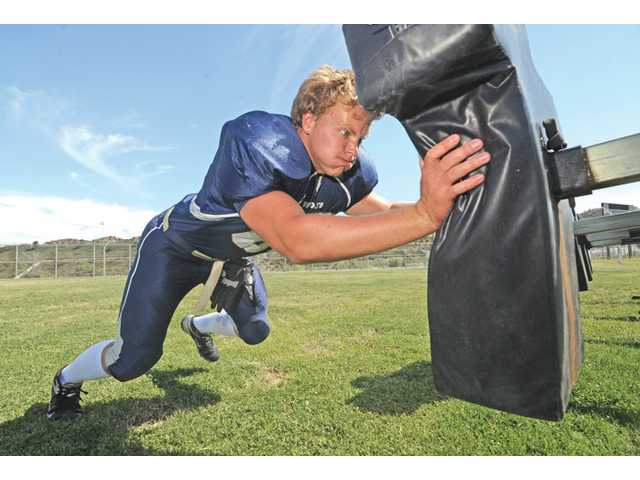 A knee injury midway through last season didn't keep West Ranch senior Jake Lambirth off the field. He finished the season as one of the league's top lineman.