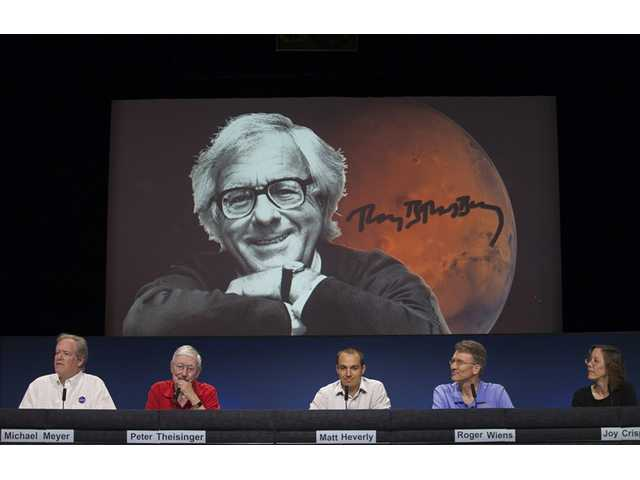 NASA scientists named the Curiosity touch-down area Bradbury Landing after writer Ray Bradbury, seen on screen, at the Jet Propulsion Laboratory in Pasadena,on Wednesday.