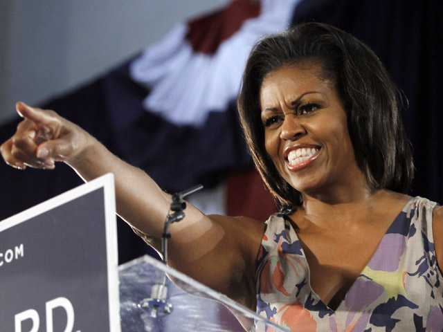 First Lady Michelle Obama points to supporters at the War Memorial auditorium Wednesday, Aug. 22, 2012 in Fort Lauderdale, Fla.