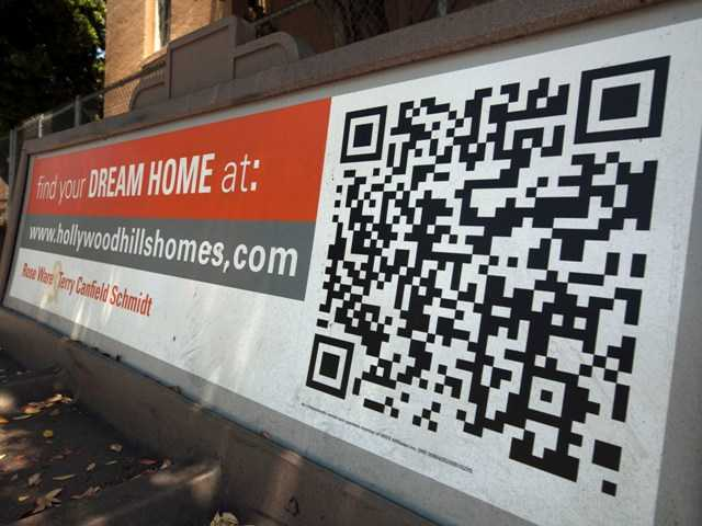 A Quick Response code is shown in this July 17 photo of a Realtor ad offering homes in the Hollywood Hills area of Los Angeles.