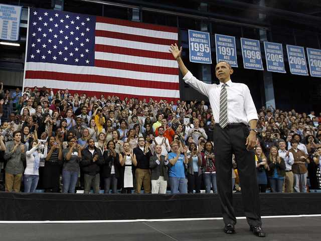 In this April 24, 2012, file photo President Barack Obama acknowledges the crowd after speaking at the University of North Carolina in Chapel Hill, N.C. Demographic changes and recent election results reveal a more nuanced landscape in southern states now as the two major parties prepare for their national conventions.