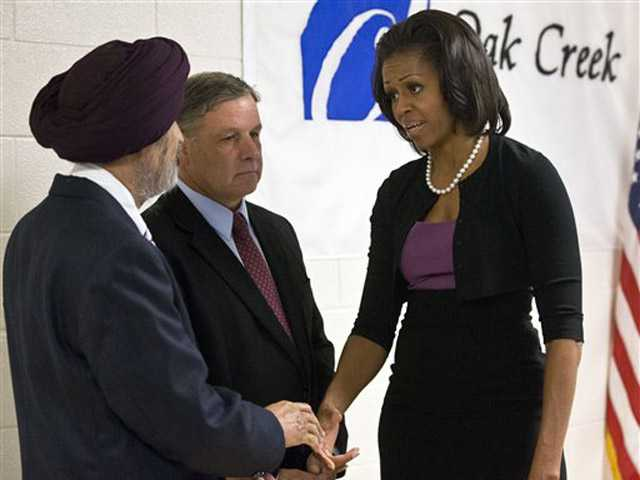 First lady Michelle Obama greets Sikh temple secretary of the board of trustees Kulwant Singh Dhaliwal, left, and Mayor Stephen Scaffidi on Thursday, before talking to victims of the Aug. 5 shooting in Oak Creek, Wis.