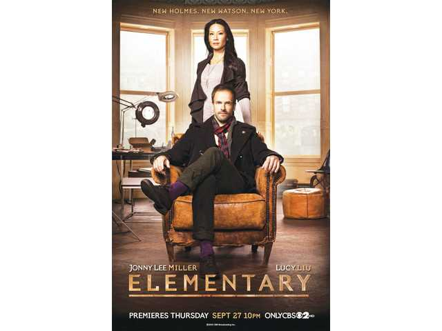 "Lucy Lu as Watson and Jonny Lee Miller as Sherlock Holmes in ""Elementary"" on CBS."