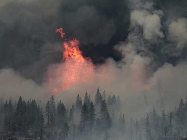 Flames and smoke from the Ponderosa Fire are seen, Monday Aug. 20, 2012, near Paynes Creek, Calif.