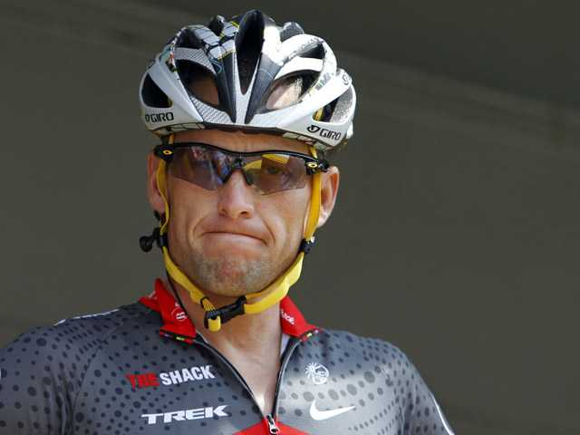 Lance Armstrong grimaces on July 6, 2010 prior to the start of the third stage of the Tour de France cycling race in Wanze, Belgium. The USADA said Thursday that it would strip Armstrong of seven Tour titles.