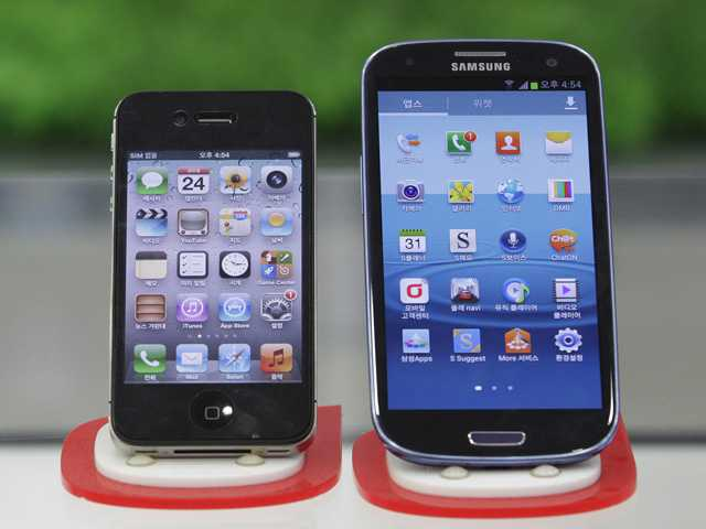 Samsung Electronics' Galaxy S III, right, and Apple's iPhone 4S are displayed at a mobile phone shop in Seoul, South Korea. After a year of scorched-earth litigation, a jury decided Friday that Samsung ripped off the innovative technology used by Apple to create its revolutionary iPhone and iPad.