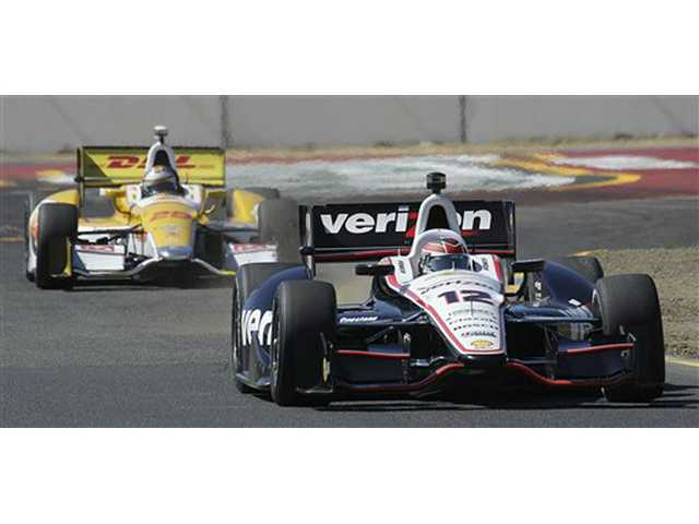 Will Power (12), of Australia, leads Ryan Hunter-Reay, of the United States, during practice for the IndyCar Series auto race Friday in Sonoma.