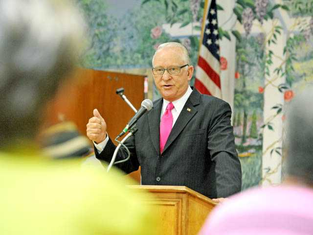 "Rep. Howard ""Buck"" McKeon, R-Santa Clarita, speaks about health care and federal budget cuts at the SCV Senior Center in Newhall on Friday."