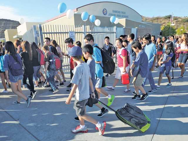 Some of the 1,018 students of Ranch Pico Junior High School head for the gates on the first day of school in Stevenson Ranch on Aug. 16.