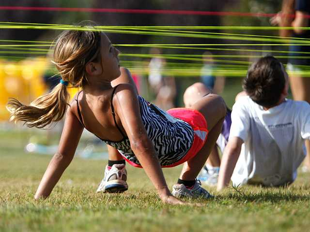 Adrianna Hill, 9, makes her way through an obstacle course at the end of a duathlon as part of the FIT DU fundraising event at West Creek Park in Saugus on Saturday.