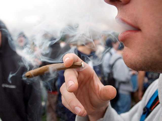 A University of Colorado freshman, who did not want to be identified, joined a crowd smoking marijuana in a 2005 file photo at the University in Boulder, Colo. Associated Press.
