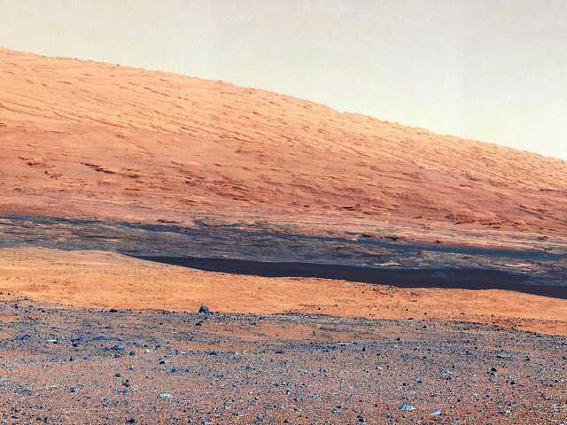 In this image released by NASA on Monday, a photo taken by the Mast Camera (MastCam) highlights the geology of Mount Sharp, a mountain inside Gale Crater, where the rover landed.